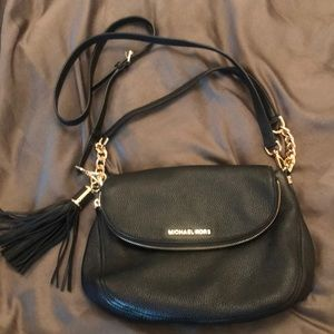 Michael Kors black leather crossbody bag.